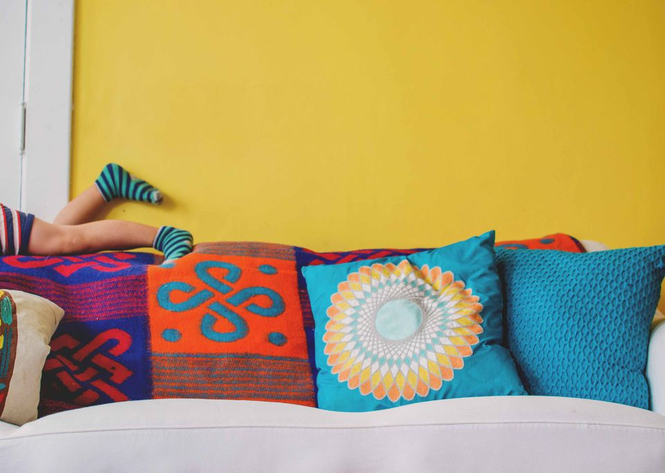 yellow wall and colorful pillows