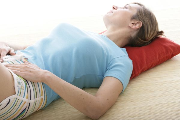 woman with pelvic pain laying down