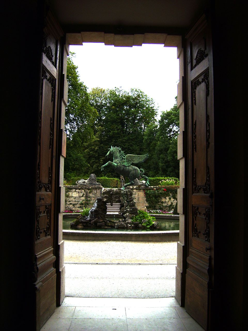Door framing fountain statue