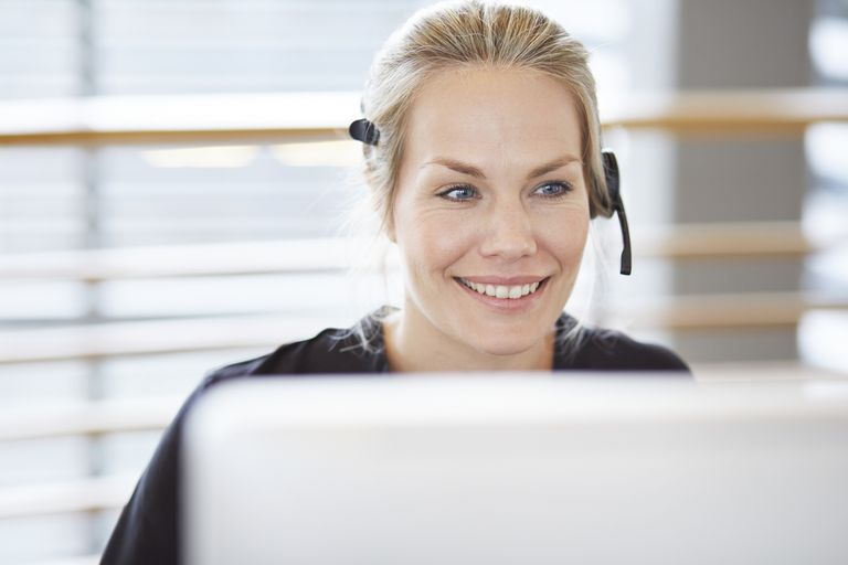Woman with headset doing phone support