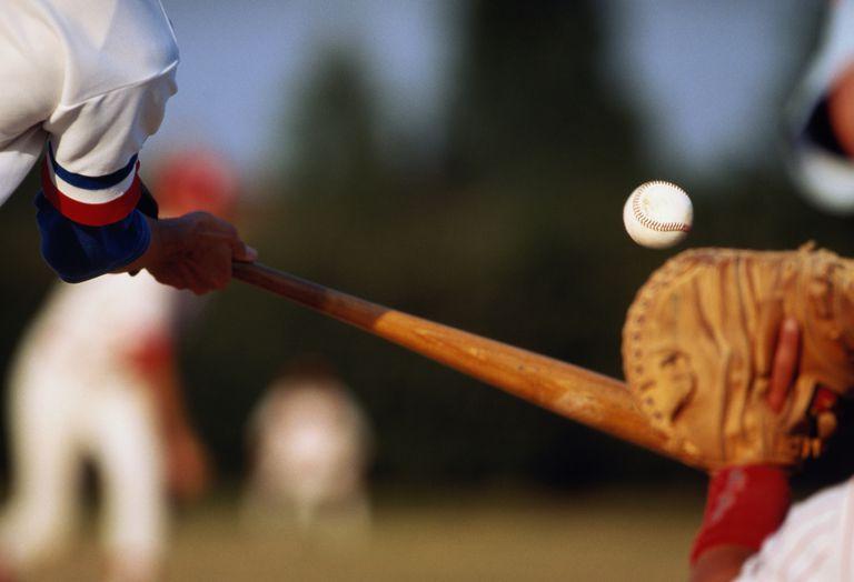 Batter missing baseball pitch