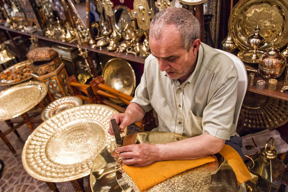 'Kingdom of Morocco, Fes, Fes el Bali, Medina of Fes - listed by UNESCO as a world heritage site in 1981, Copper Souk, Craftsman working on copperware'
