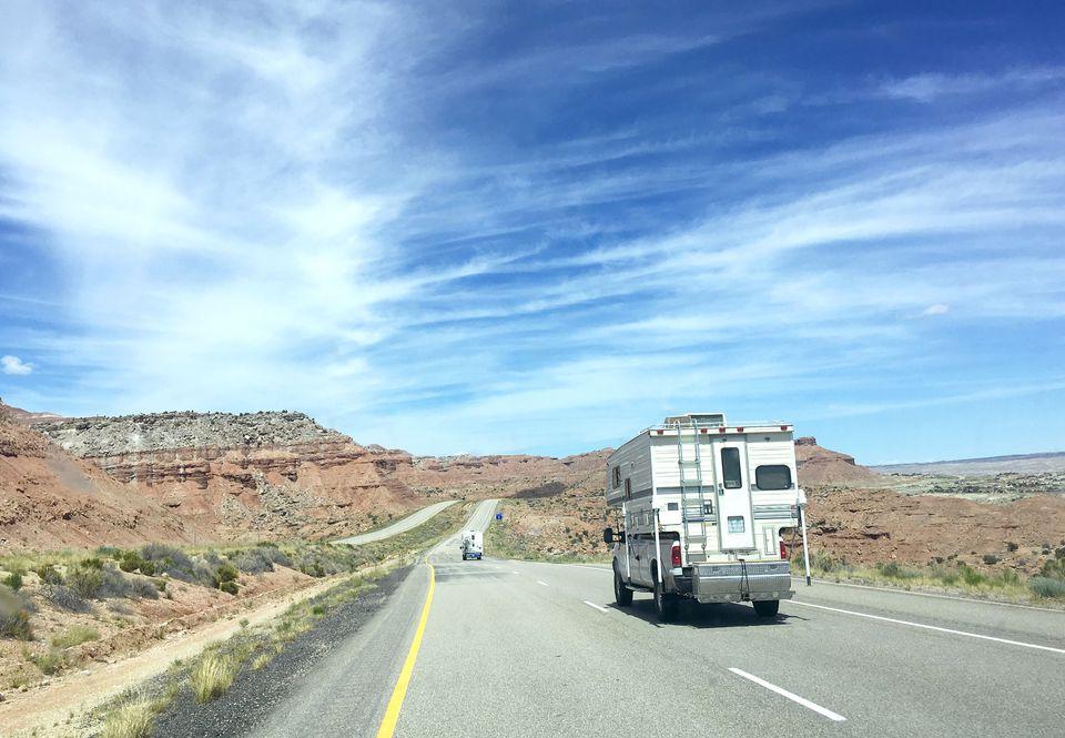 Campers driving down highway/Interstate 15, Utah.