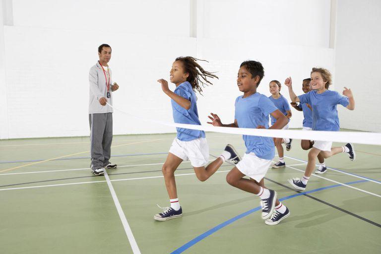 Children running in a gymnasium.