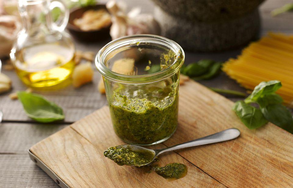 Preserving jar of homemade basil pesto