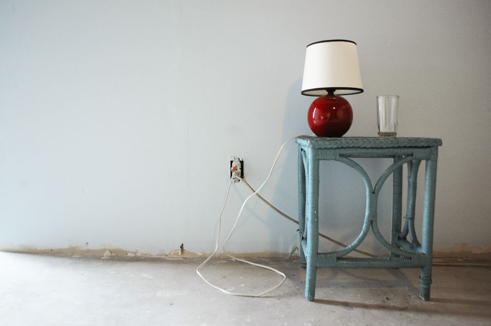 Red lamp and glass on table
