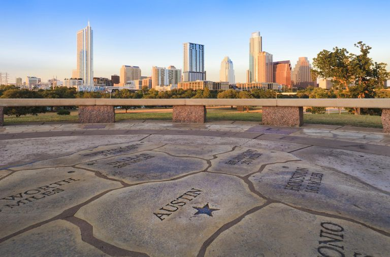 Map of Texas with Austin skyline in background