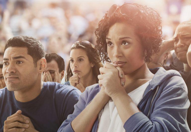 Tense spectators watching sporting event