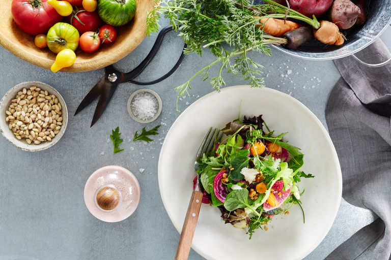 Salad and vegetables on a table