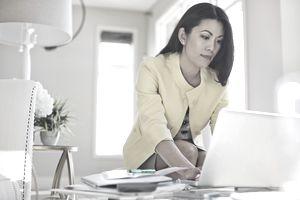 Financial advisor working on laptop