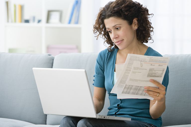 A woman reviews her credit card billing statement
