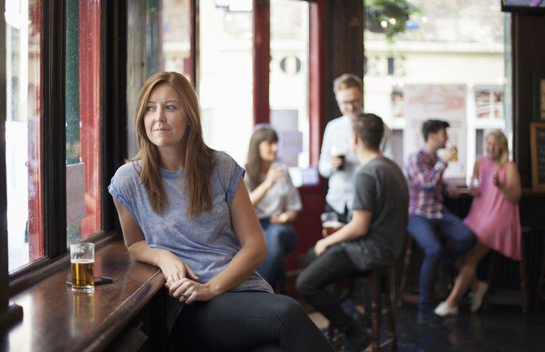 single woman in a pub