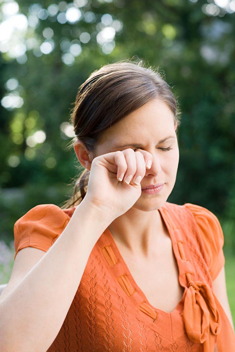 Woman rubbing eye