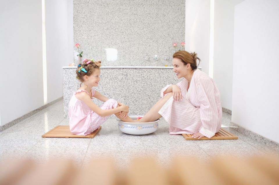 Mother and daughter getting pedicures