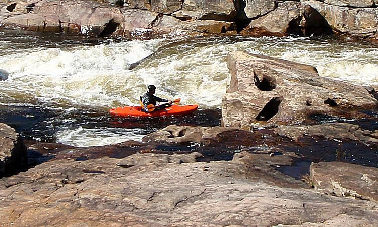 A Kayaker Eddies-Out