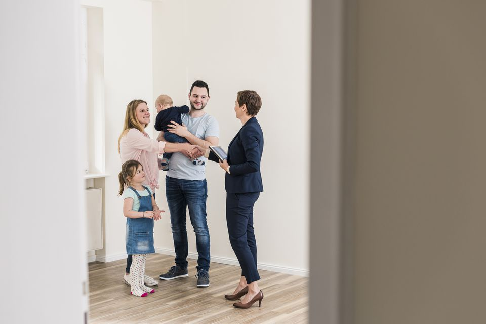 Family moving into apartment