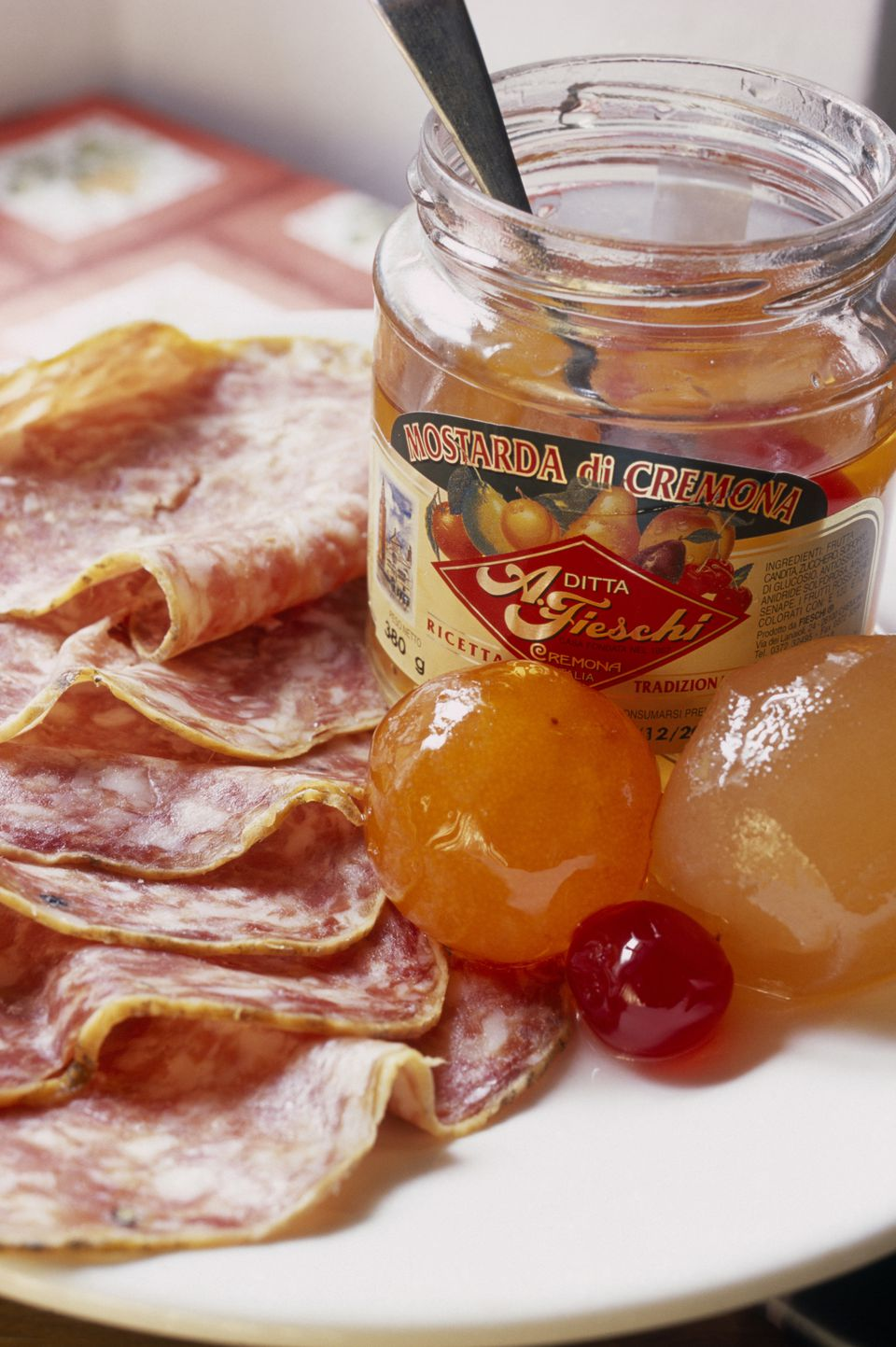 Mostarda from Cremona with a plate of salame