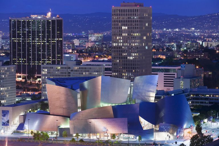 Gehry's twirly metal Disney Concert Hall in front of traditional office buildings in Los Angeles