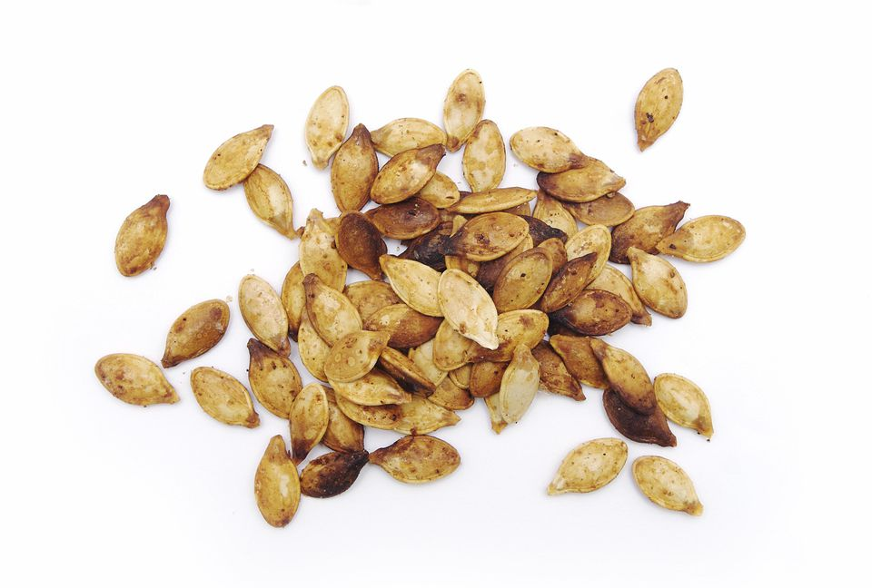 Fresh Roasted Pumpkin Seeds Isolated on White