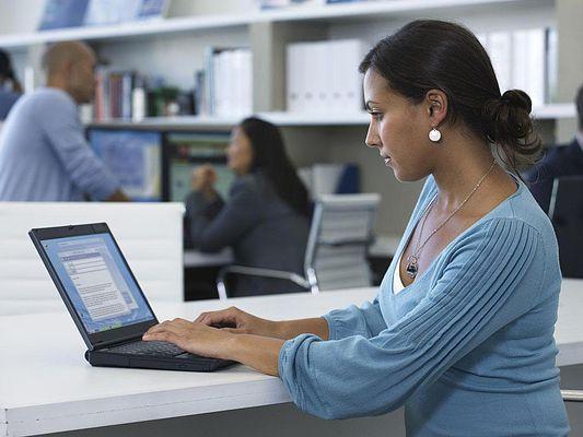 woman working on laptop in sm mod office
