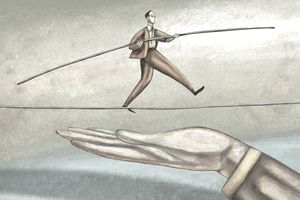 Man walking a tightrope with a safety net