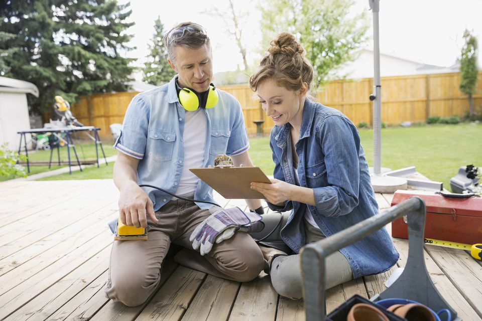 Image of couple working on building a deck.