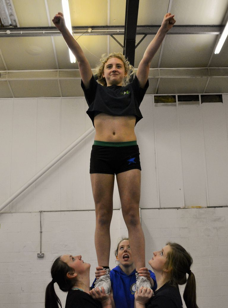 Learn To Do A Full Down Cradle In Cheerleading