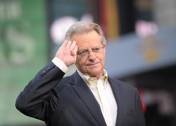 Talk Show Host Jerry Springer salutes to fans.