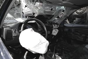 Inside of a car with a deployed airbag