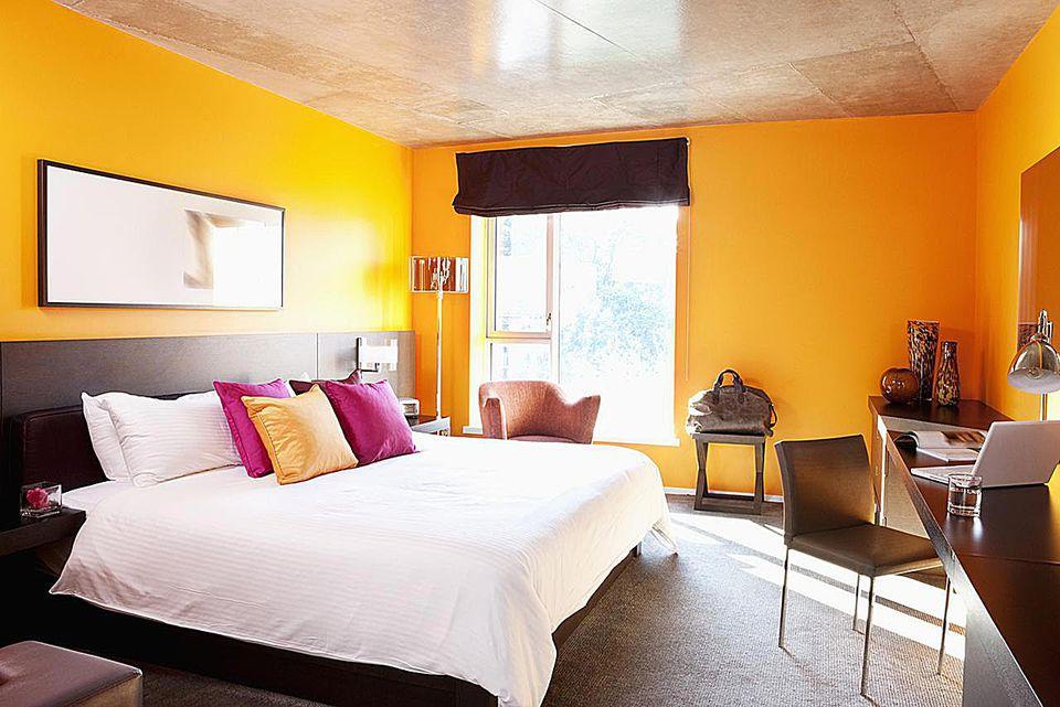 Empty orange bedroom.
