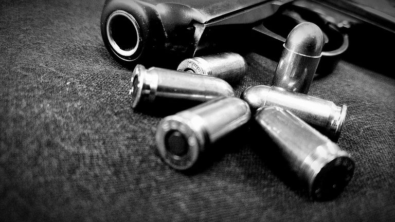 Close-Up Of Handgun And Bullets