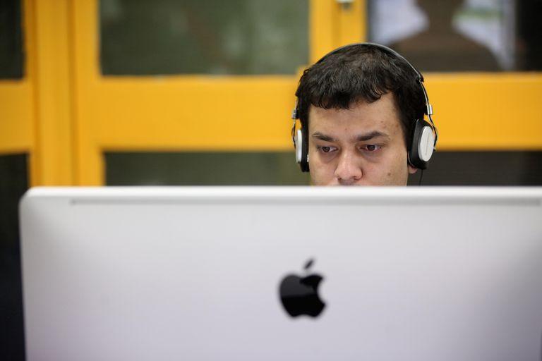 Man working on an iMac