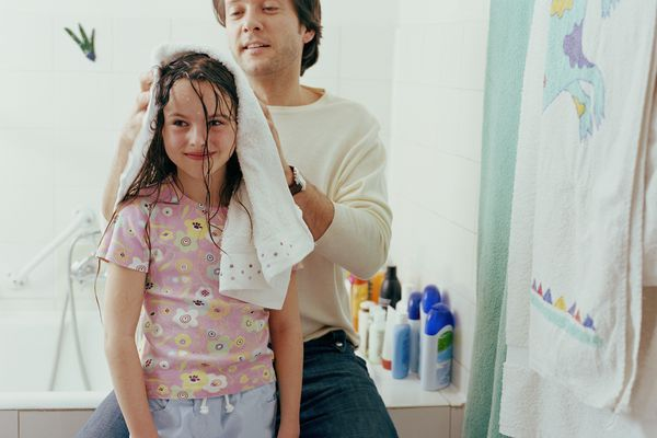 Dad drying daughters hair