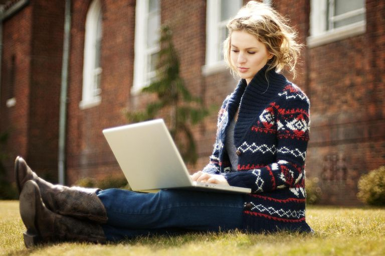 Female student working on laptop at university