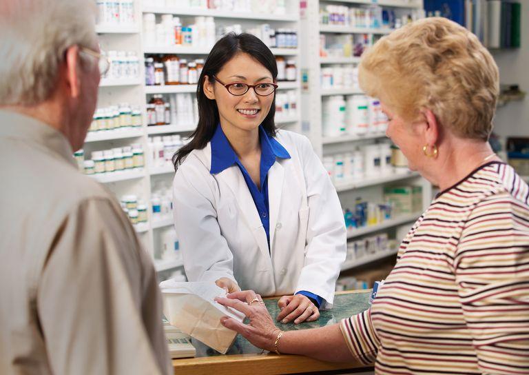 Pharmacy Counter Pharmacist helping customers