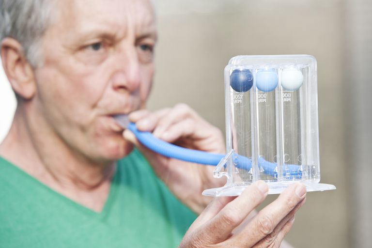 A man takes a lung function test.