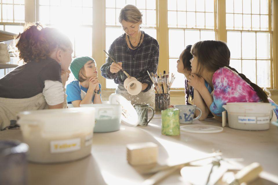 Pottery class demonstrating glaze