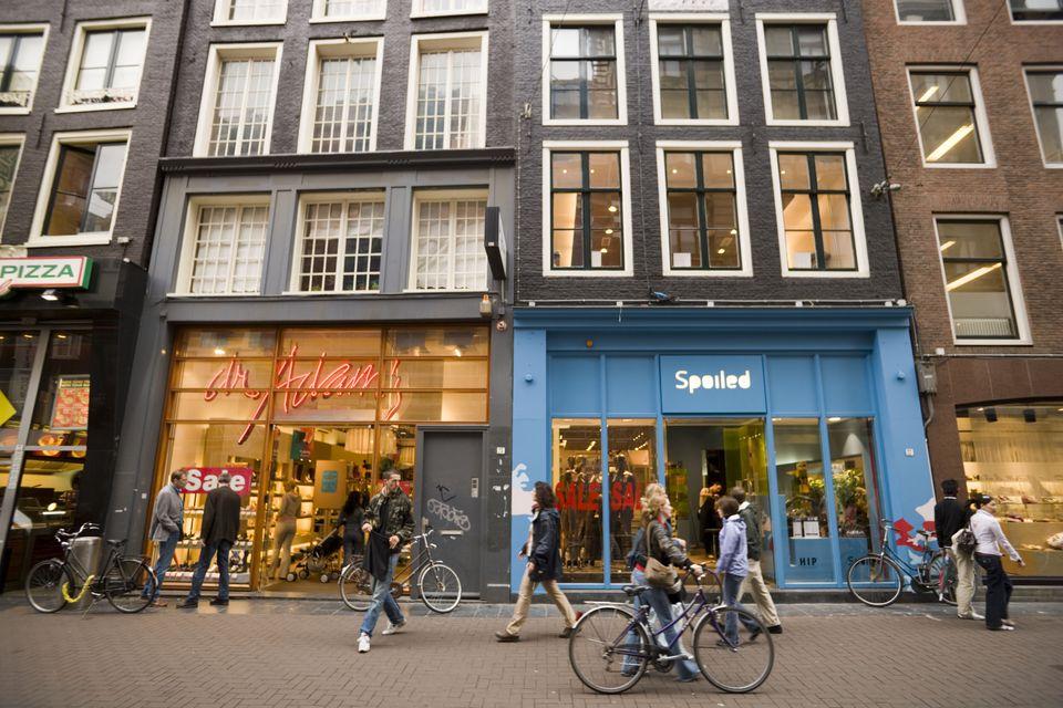 People passing shop-windows in Leidsestraat, Amsterdam, Holland, Netherlands