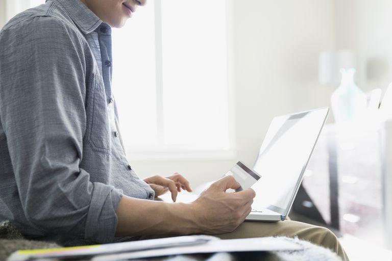 A man pays credit card bill online