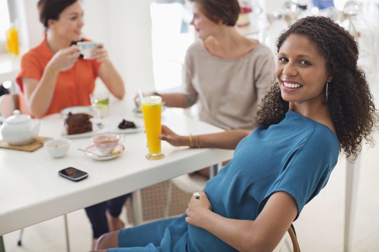 Pregnant woman at the dinner table