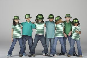 Kids wearing St. Patrick's Day hats.