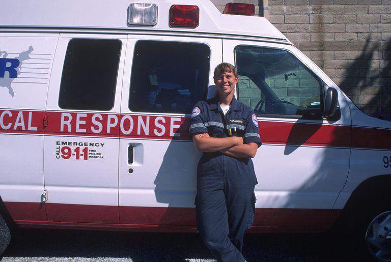 paramedic next to an ambulance