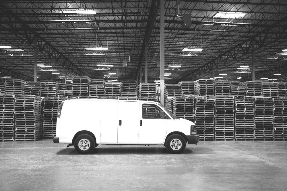 Cargo van parked in an empty warehouse