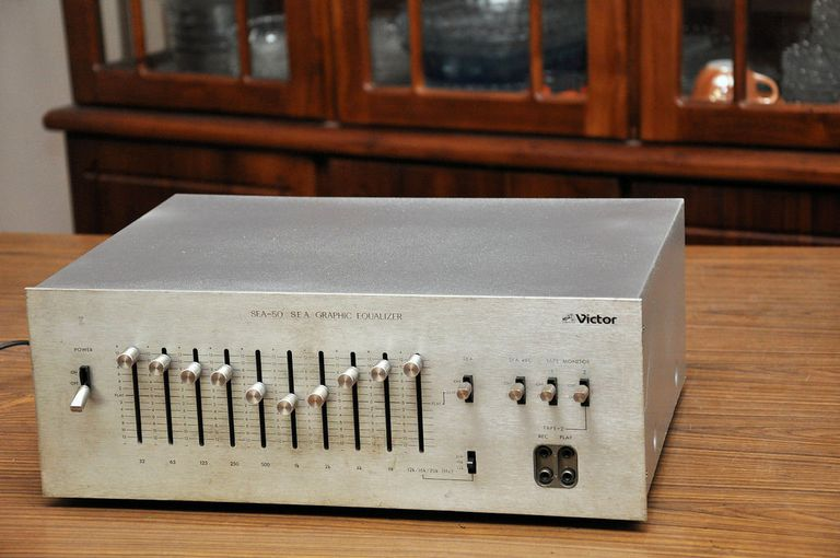 A graphic equalizer for home theater system on top of a table