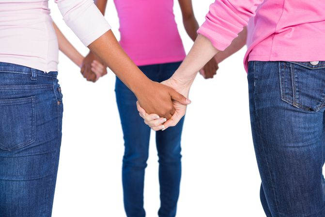 Breast Cancer women holding hands