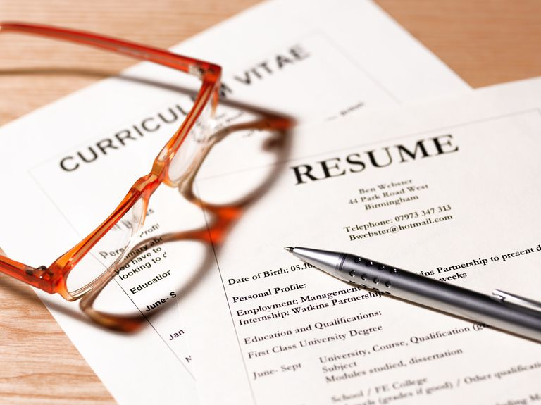 cv and resume with glasses and pen - Resume Qualifications