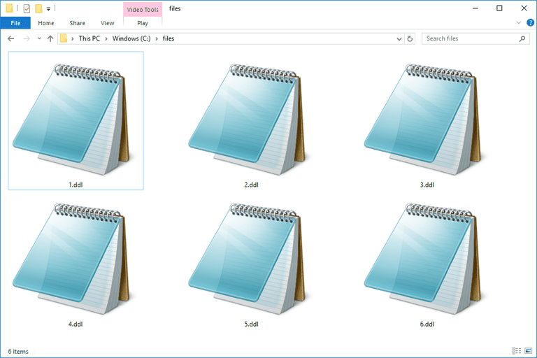 Screenshot of several DDL files in Windows 10 that open with Notepad