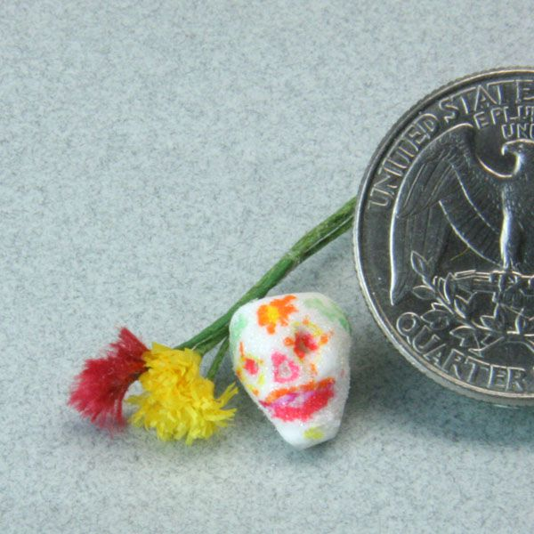 Finished marigold and cockscomb flowers shown with a miniature sugar skull for the Day of the Dead