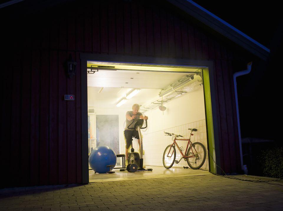 Man working out in a garage, Sweden.