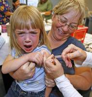 Crowds Line Up For H1N1 Flu Vaccinations